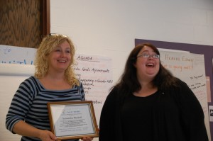 Sam Maskell from the Rockingham Free Public Library being presented the ACE Award by Deb Witkus